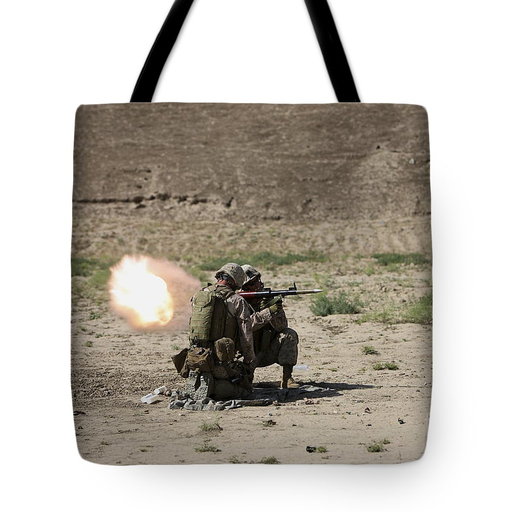 Kunduz Tote Bag featuring the photograph U.s. Marines Fire A Rocket-propelled by Terry Moore