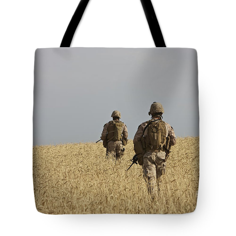 Afghanistan Tote Bag featuring the photograph U.s. Marines Patrol A Wadi Near Kunduz by Terry Moore