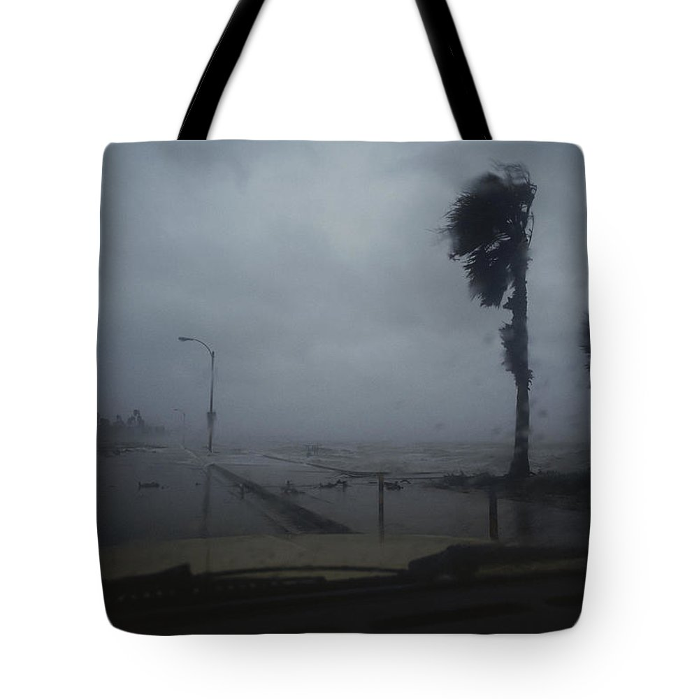 View From A Vehicle Of Hurricane Allen Striking Corpus Christi. Tote Bag featuring the photograph View From A Vehicle Of Hurricane Allen by Annie Griffiths