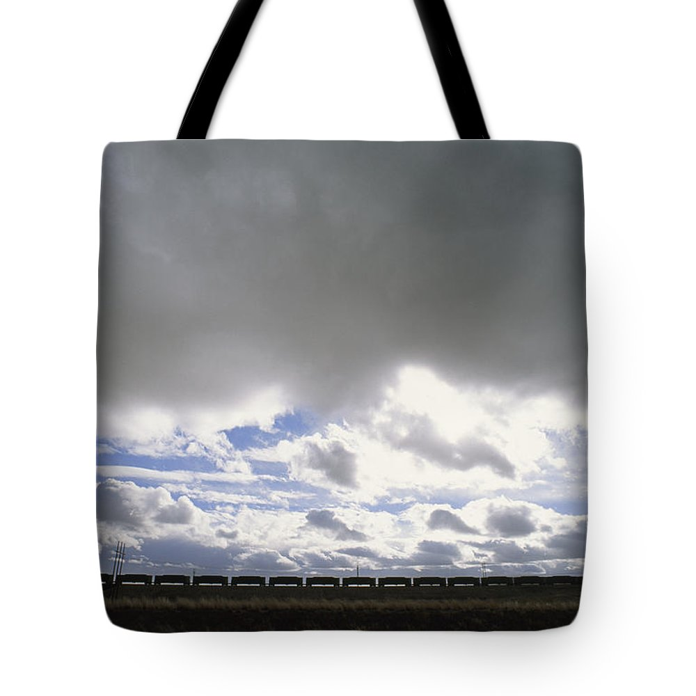 North America Tote Bag featuring the photograph View Of A Train Carrying Coal by James P. Blair