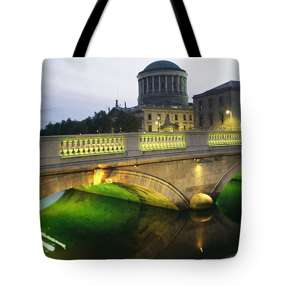 Structures Tote Bag featuring the photograph View Of The Four Courts And The Liffey by Richard Nowitz