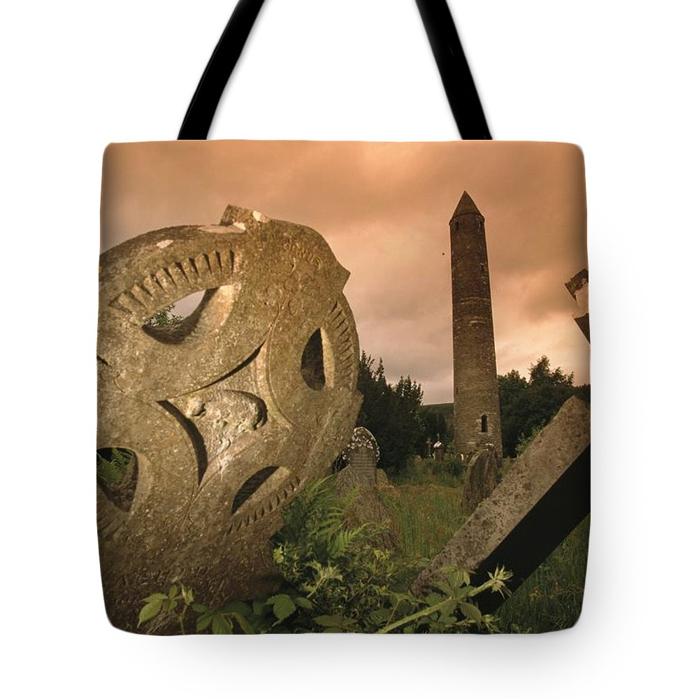 Europe Tote Bag featuring the photograph View Of The Round Tower And Gravestones by Richard Nowitz