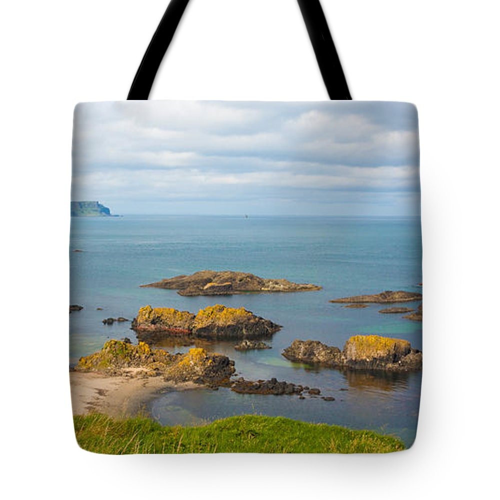 Europe Tote Bag featuring the photograph Volcanic Rock Formations In Ballintoy Bay by Semmick Photo