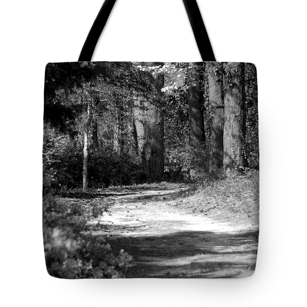 Black And White Tote Bag featuring the photograph Walking In The Springtime Woods In Black And White by Suzanne Gaff