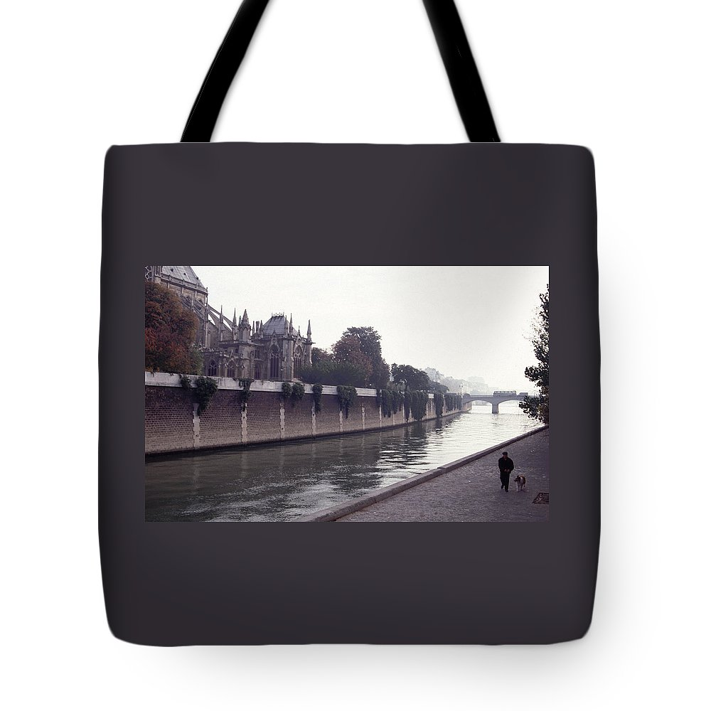 Paris Tote Bag featuring the photograph Walking The Dog Along The Seine by Tom Wurl