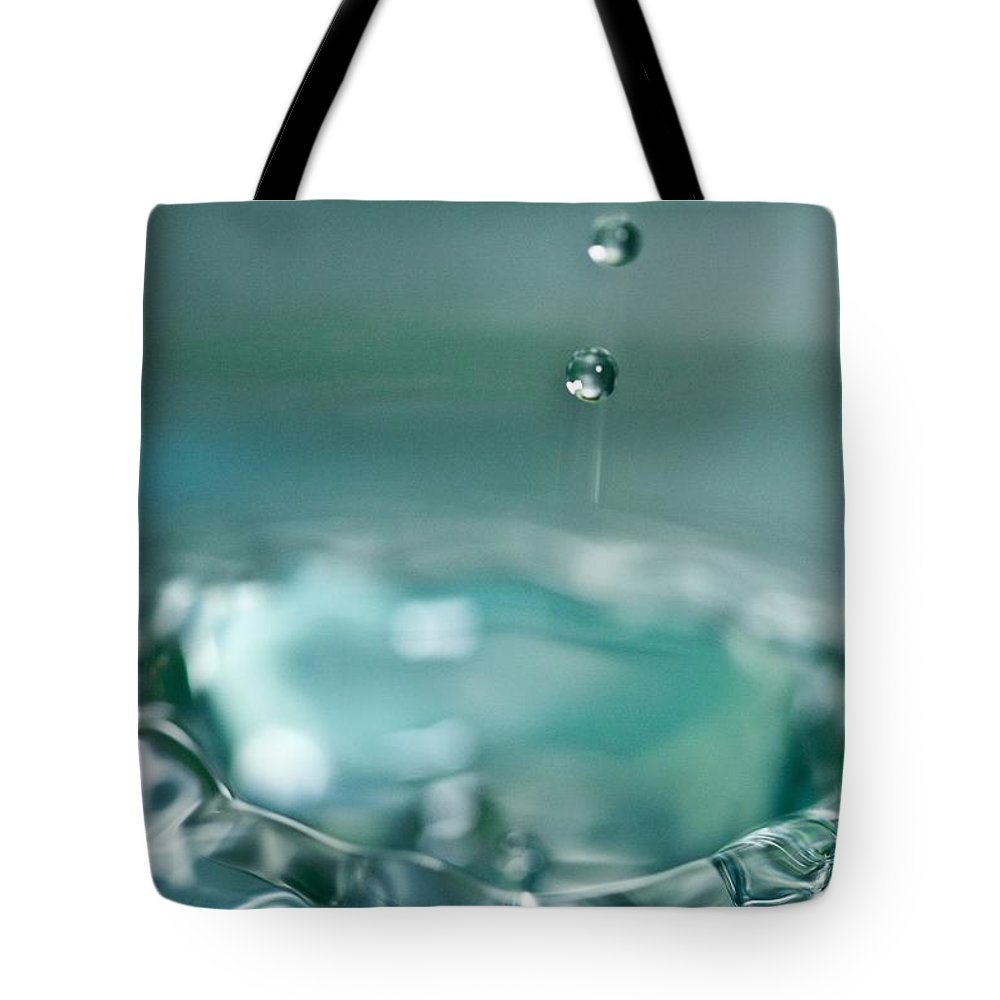 Waterdrop Tote Bag featuring the photograph Waterdrop2 by Danielle Silveira