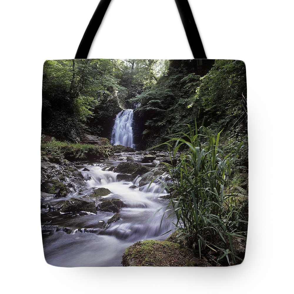 Co Antrim Tote Bag featuring the photograph Waterfall In A Forest, Glenoe by The Irish Image Collection