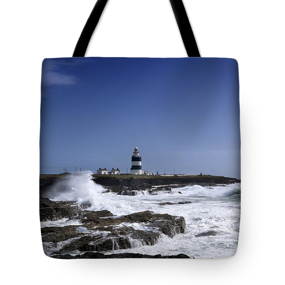 Photography Tote Bag featuring the photograph Waves Crash Against The Wexford Coast by Chris Hill