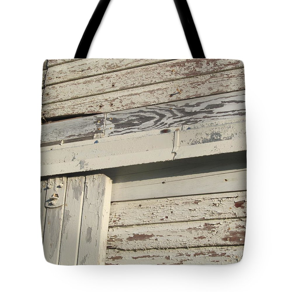Barn Tote Bag featuring the photograph Weathered North Barn Door by Tina M Wenger