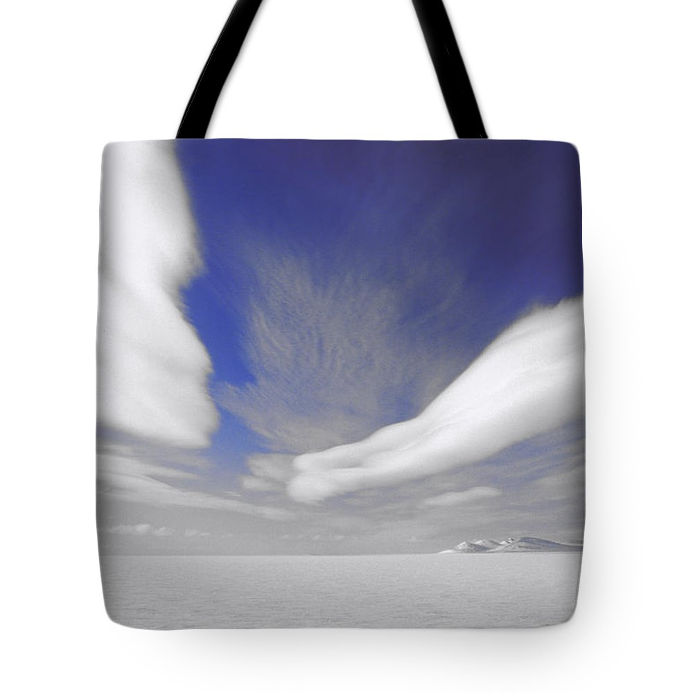Cloud Tote Bag featuring the photograph Western Axel Nunavut by Jerry Kobalenko
