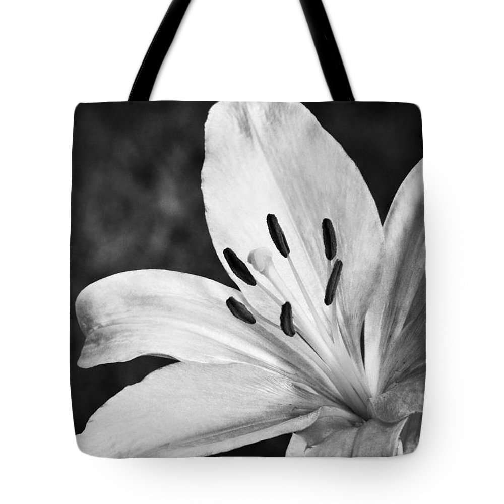 White Lilly Tote Bag featuring the photograph White Lilly by Saija Lehtonen