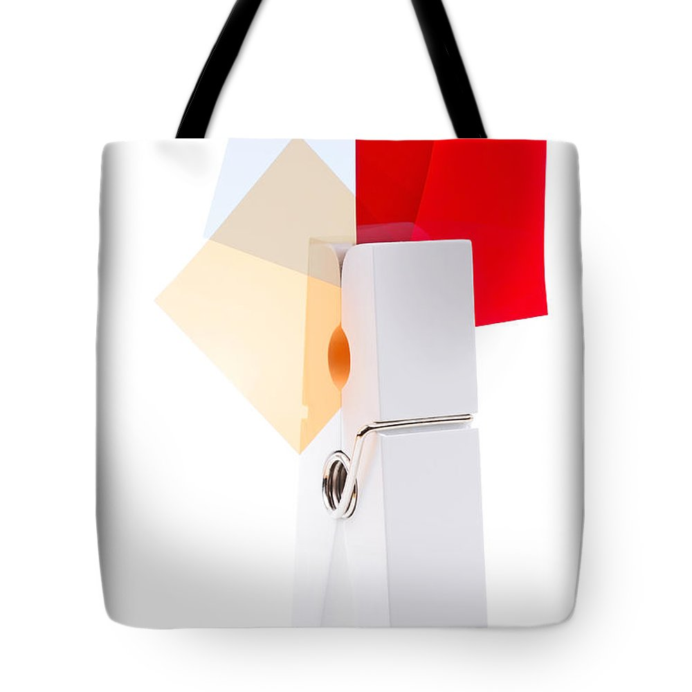 Peg Tote Bag featuring the photograph White Peg Holding Squares by Simon Bratt Photography LRPS