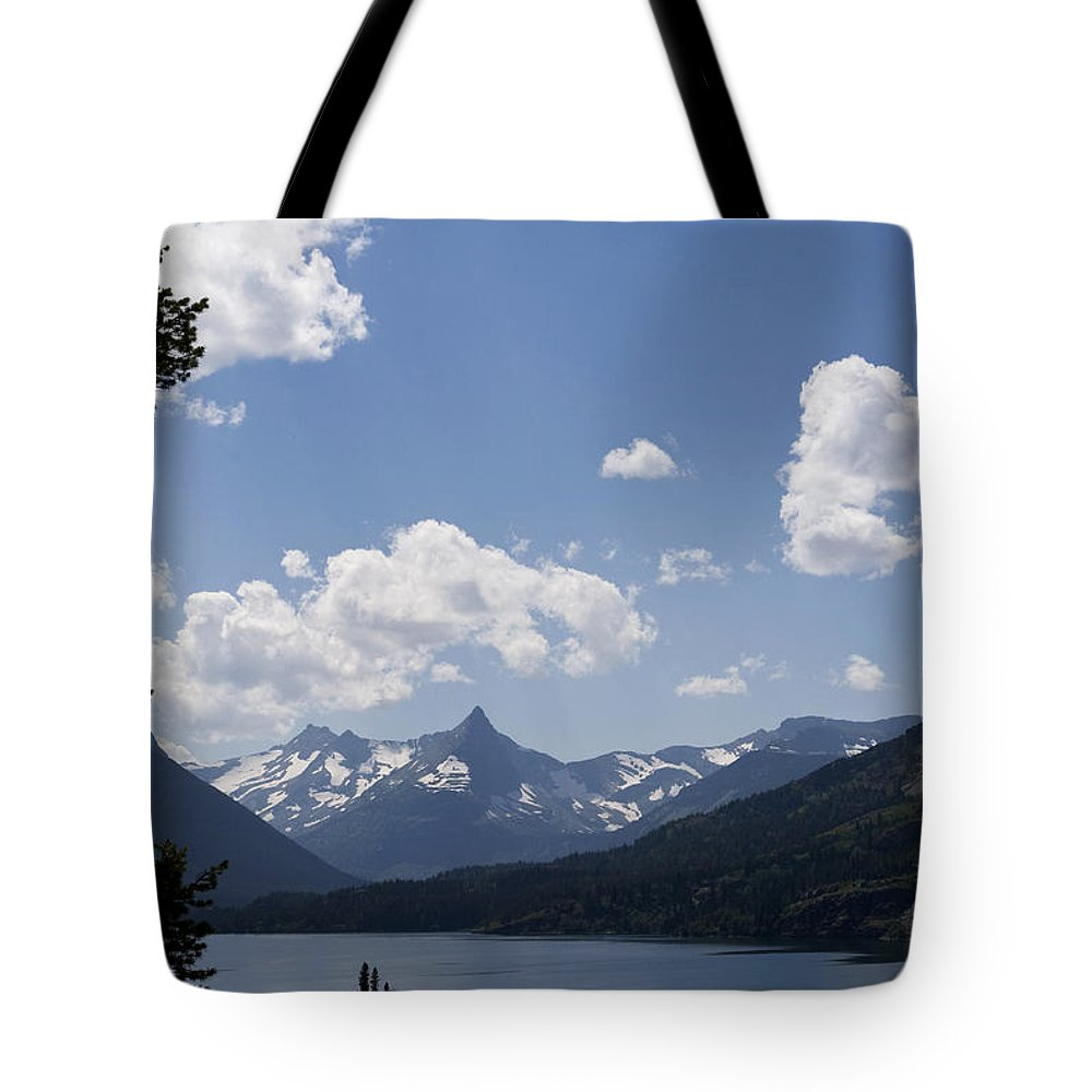 Goose Island Tote Bag featuring the photograph Wild Goose Island Floats In St Mary Lake by Lorraine Devon Wilke