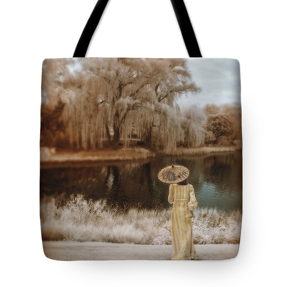 Young Tote Bag featuring the photograph Woman In Vintage Dress With Parason By Lake by Jill Battaglia