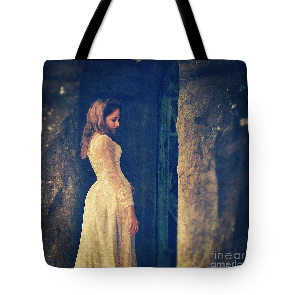 Lady In Doorway Tote Bag featuring the photograph Woman In White In Doorway by Jill Battaglia