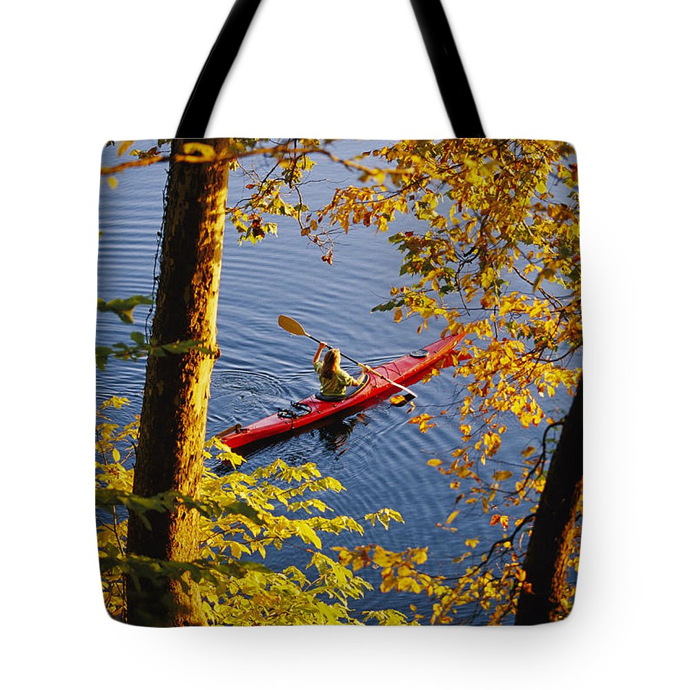 Boats Tote Bag featuring the photograph Woman Kayaking With Fall Foliage by Skip Brown