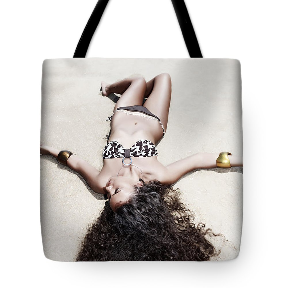 Girl Tote Bag featuring the photograph Woman Sunbathing by MotHaiBaPhoto Prints