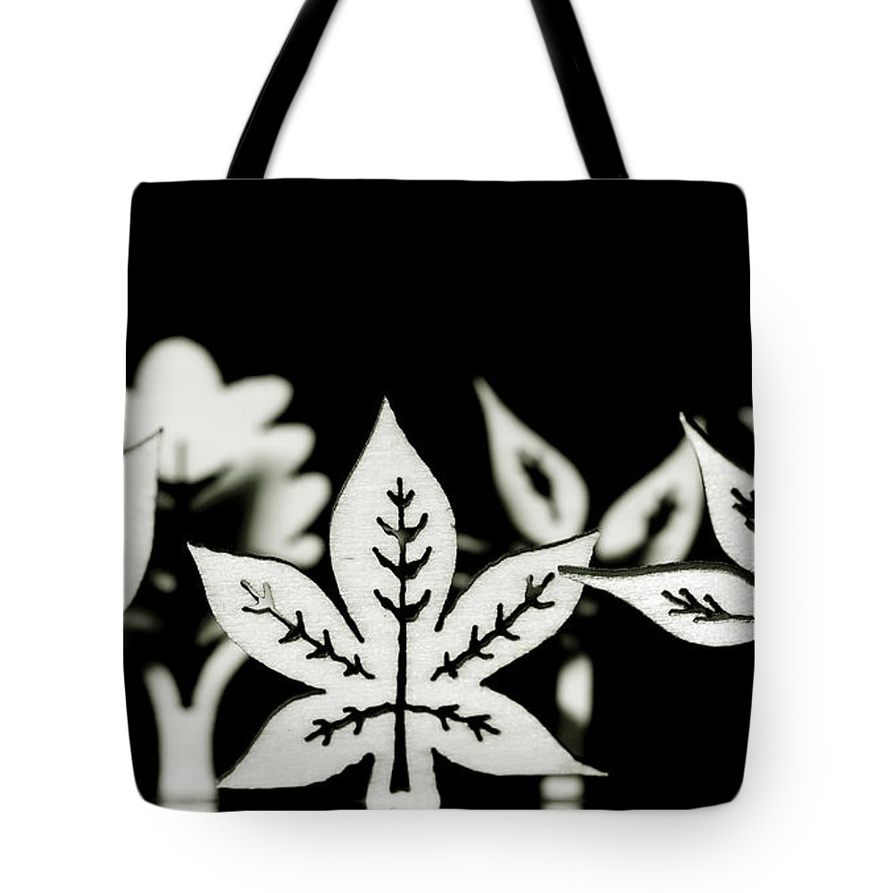 Leaf Tote Bag featuring the photograph Wooden Leaf Shapes In Black And White by Simon Bratt Photography LRPS