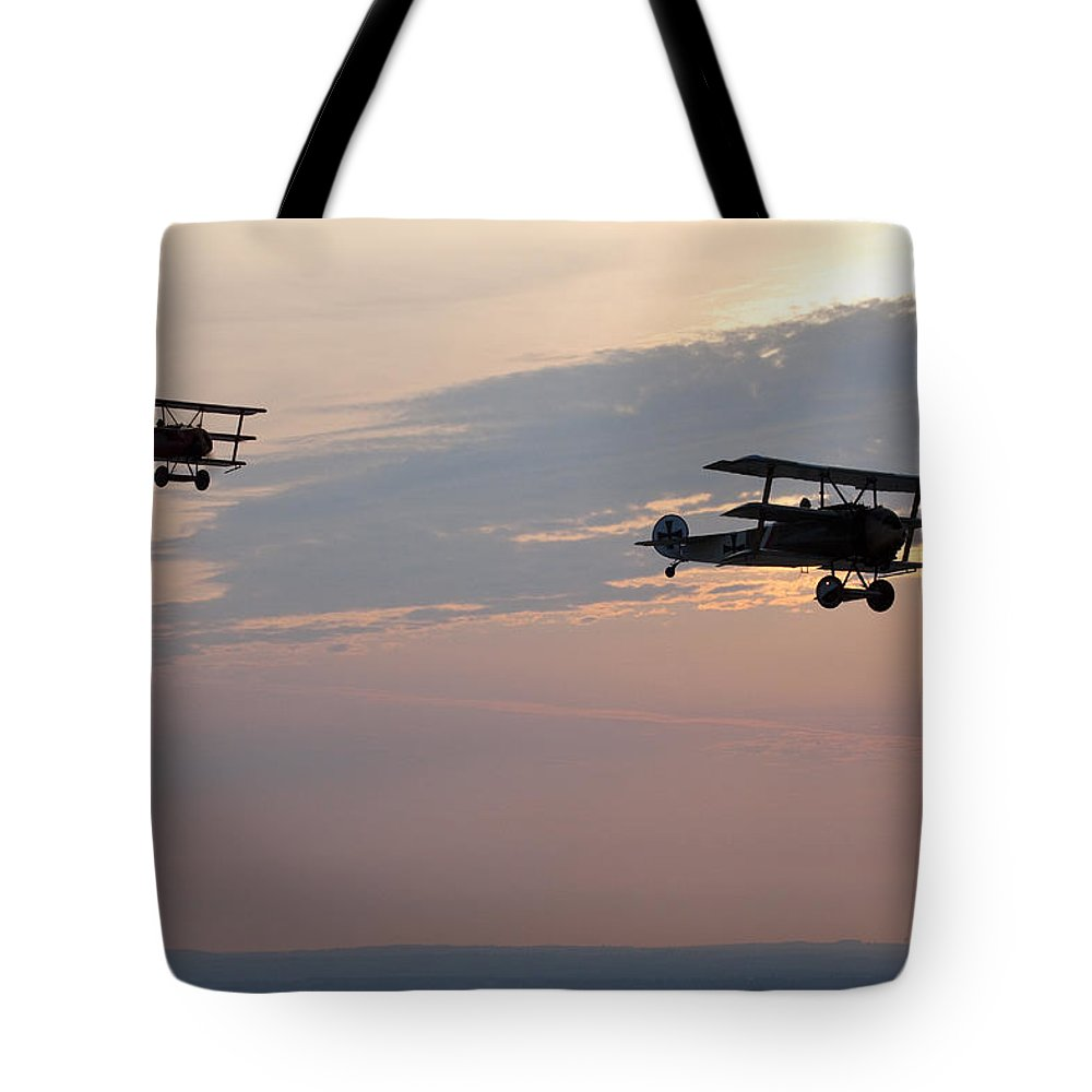 Day Tote Bag featuring the photograph World War I Triplanes In Flight by Pete Ryan