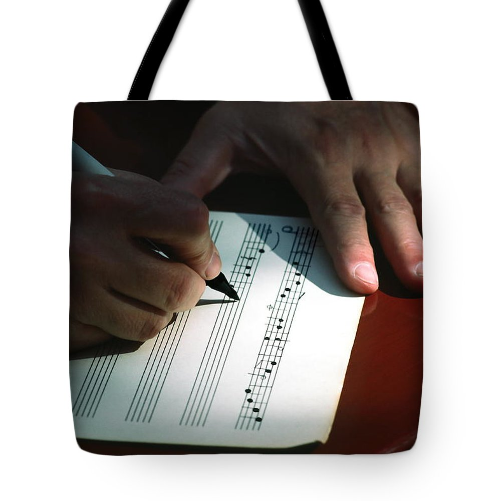 Hands Writing Musical Notes Tote Bag featuring the photograph Writing Music by Sally Weigand