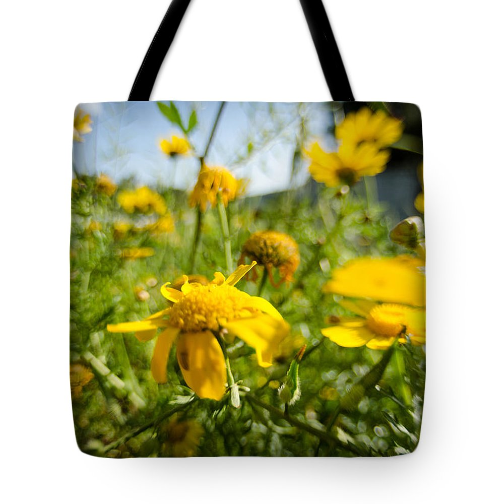 Background Tote Bag featuring the photograph Yellow Blooming Wildflowers by Michael Goyberg