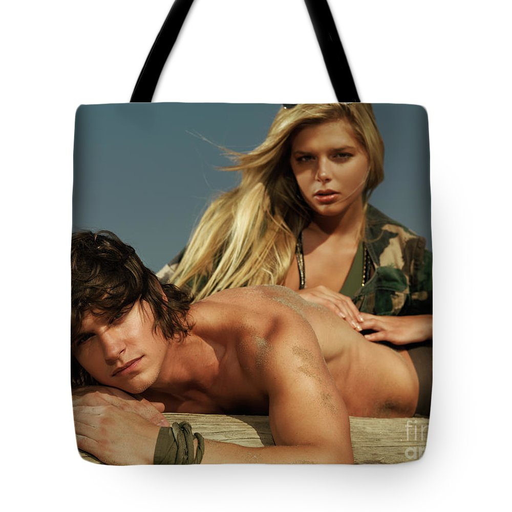Couple Tote Bag featuring the photograph Young Beautiful Couple At The Beach by Oleksiy Maksymenko