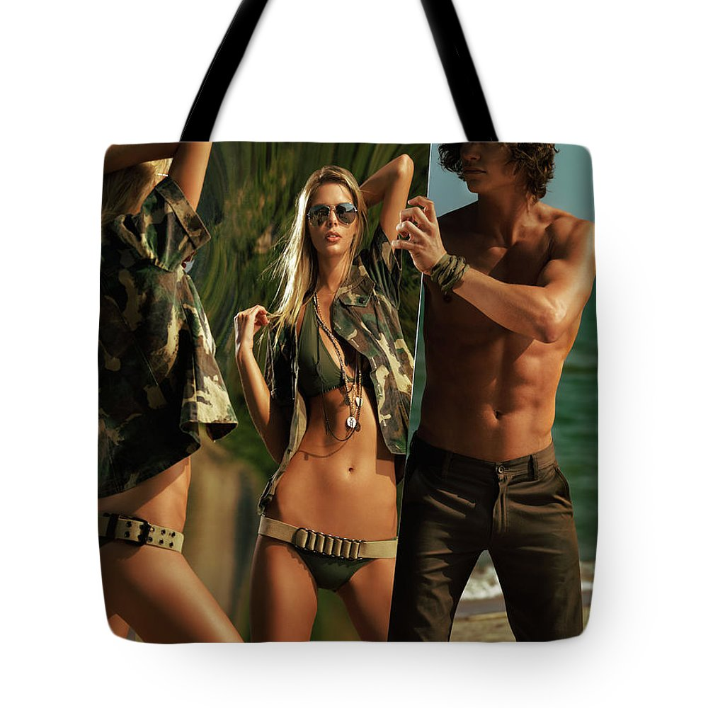 Couple Tote Bag featuring the photograph Young Man Holding A Mirror For A Woman by Oleksiy Maksymenko