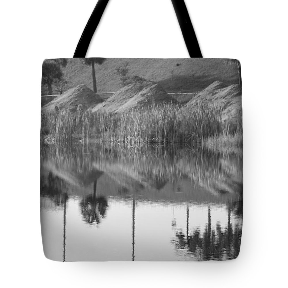Pyrimids Tote Bag featuring the photograph Pyrimids By The Lakeside Cache by Rob Hans