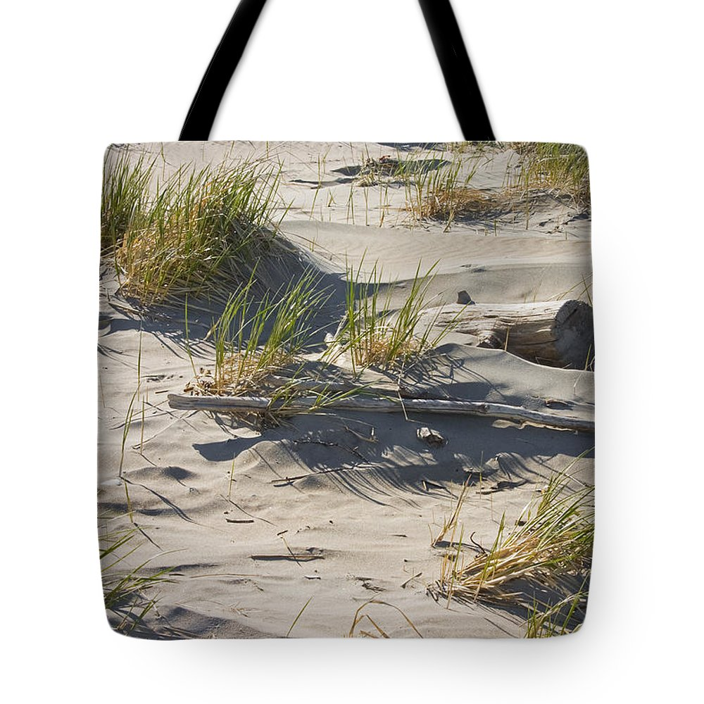 Sand Tote Bag featuring the photograph Sand And Driftwood Popham Beach Maine by Keith Webber Jr
