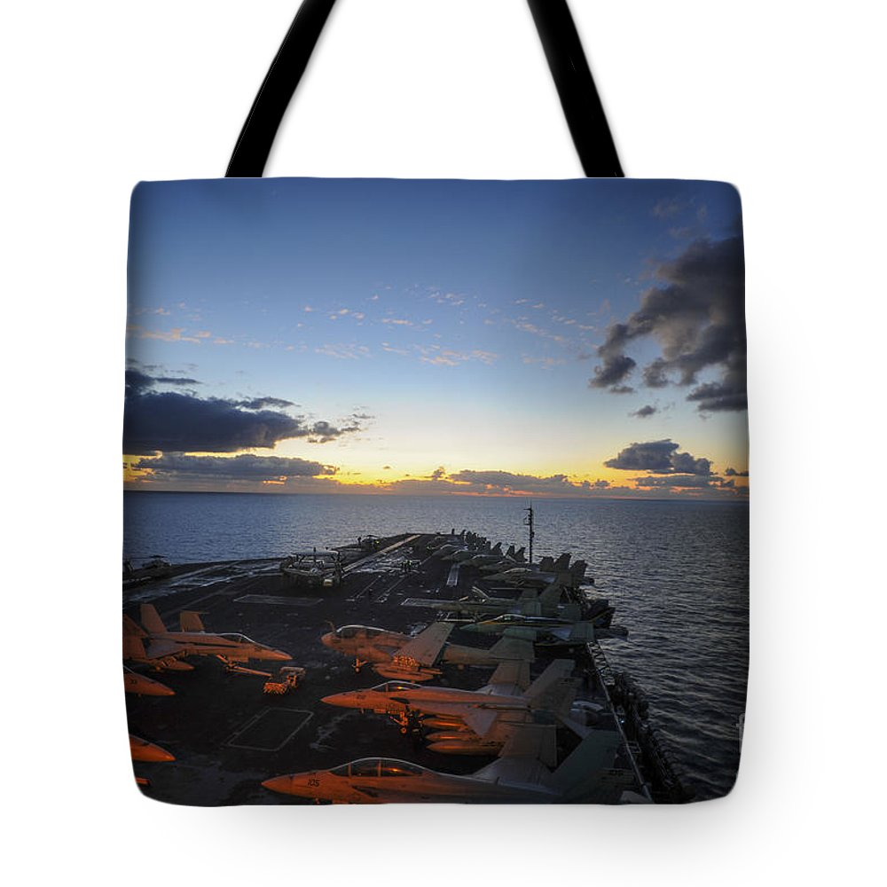 Sailors Tote Bag featuring the painting The Aircraft Carrier Uss Nimitz by Celestial Images