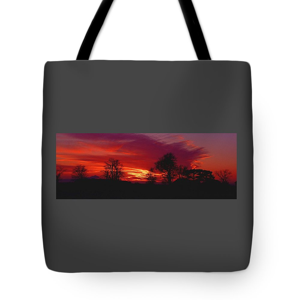Sunset Tote Bag featuring the photograph 022107-37 by Mike Davis
