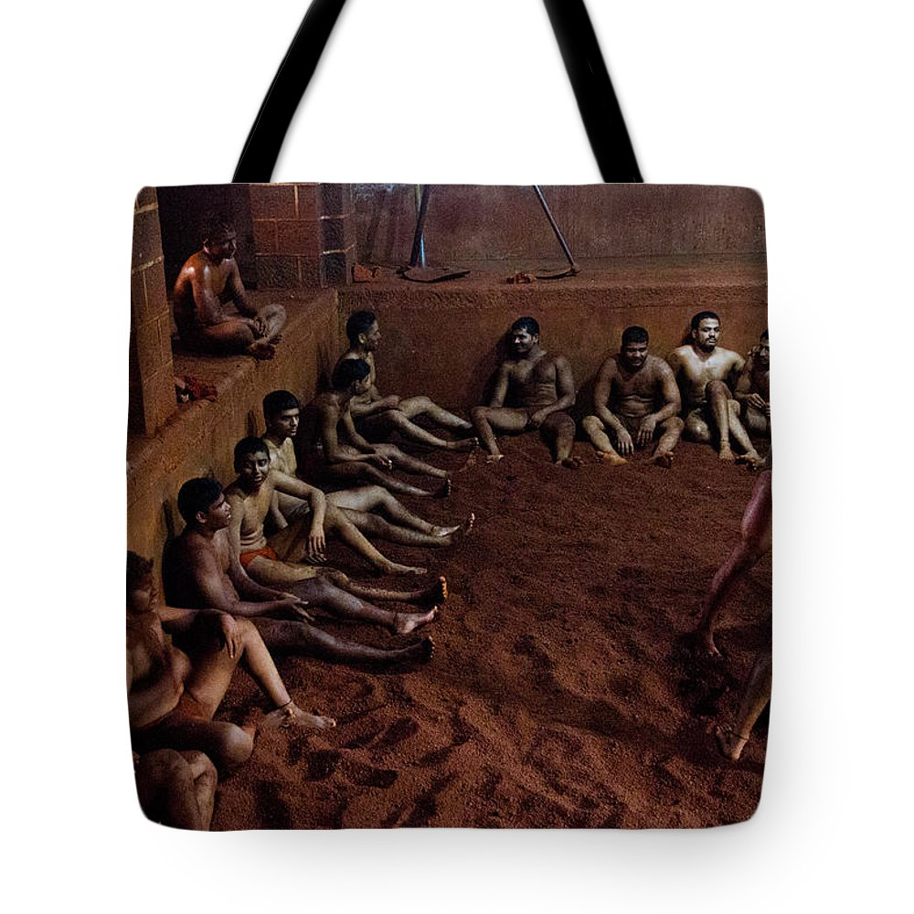 Wrestlers Tote Bag featuring the photograph ancient wrestlers of India by Indrajit Khambe
