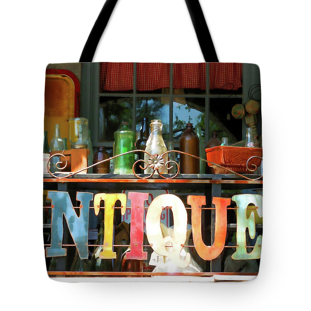 Antique Tote Bag featuring the painting Antique by Jeelan Clark
