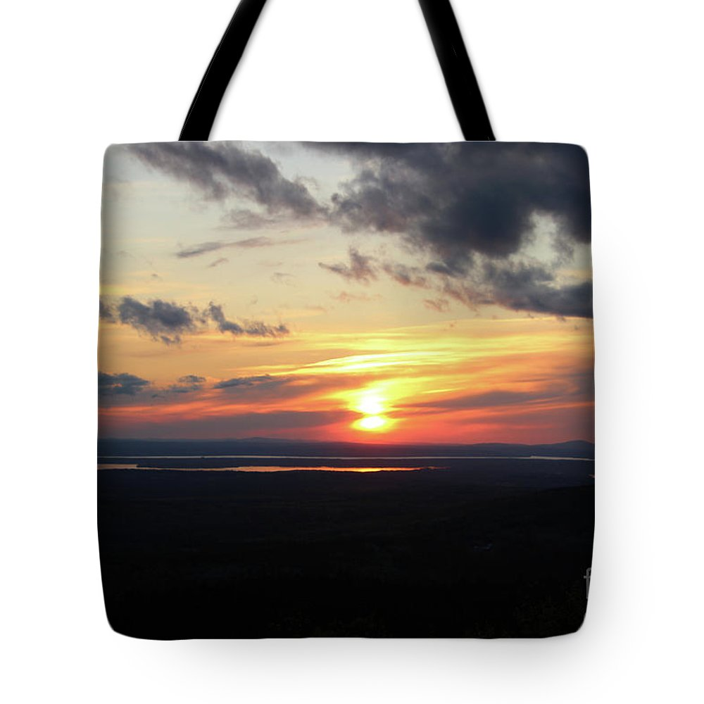 Sunset Tote Bag featuring the photograph As The Sun Goes Down by Nicole Engelhardt
