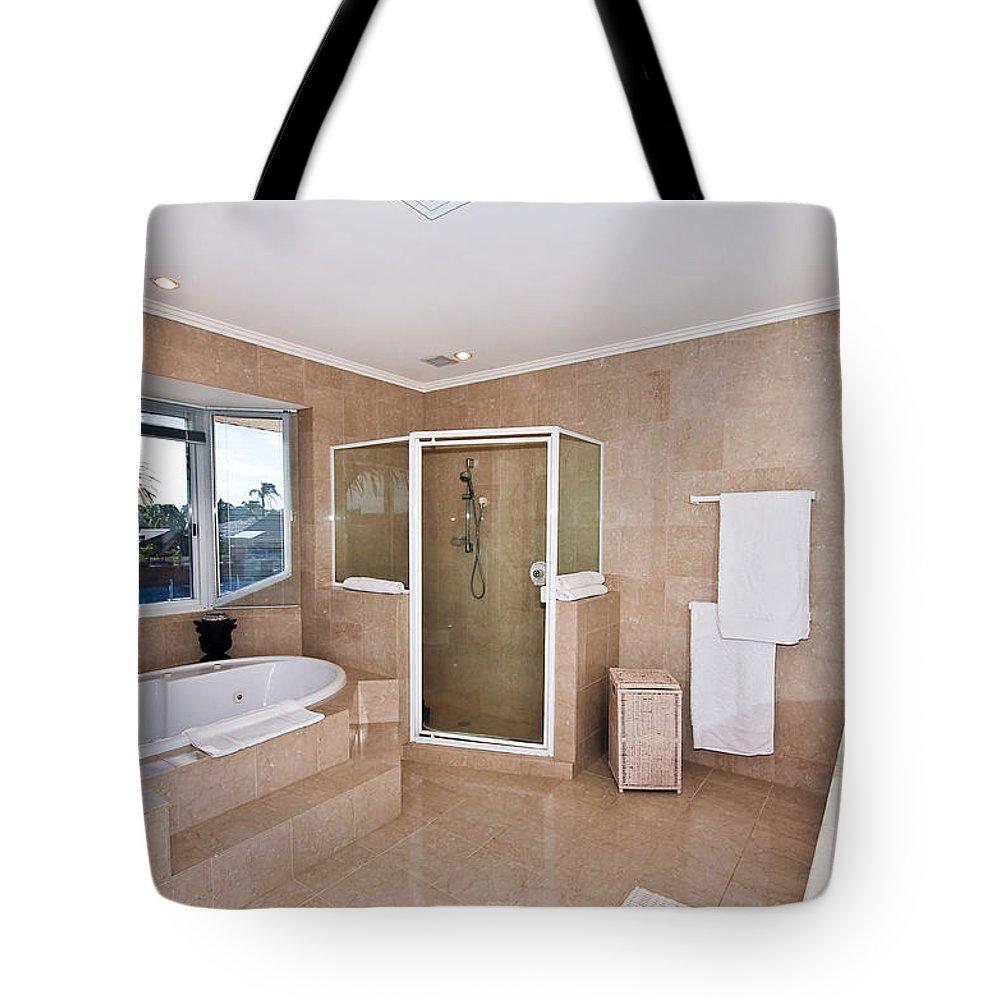 Spa Tote Bag featuring the photograph Bathroom And Spa Bath by Darren Burton