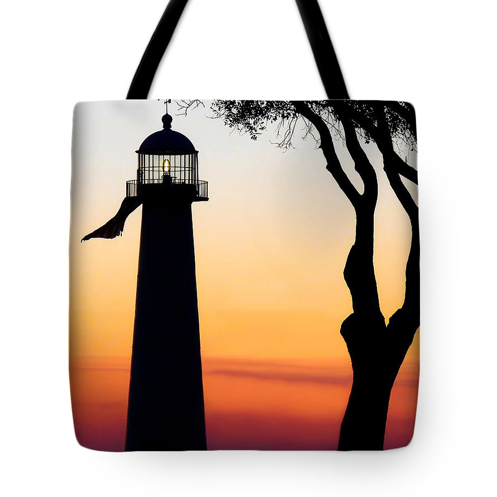 Biloxi Lighthouse Tote Bag featuring the photograph Biloxi Lighthouse At Dusk by Joan McCool