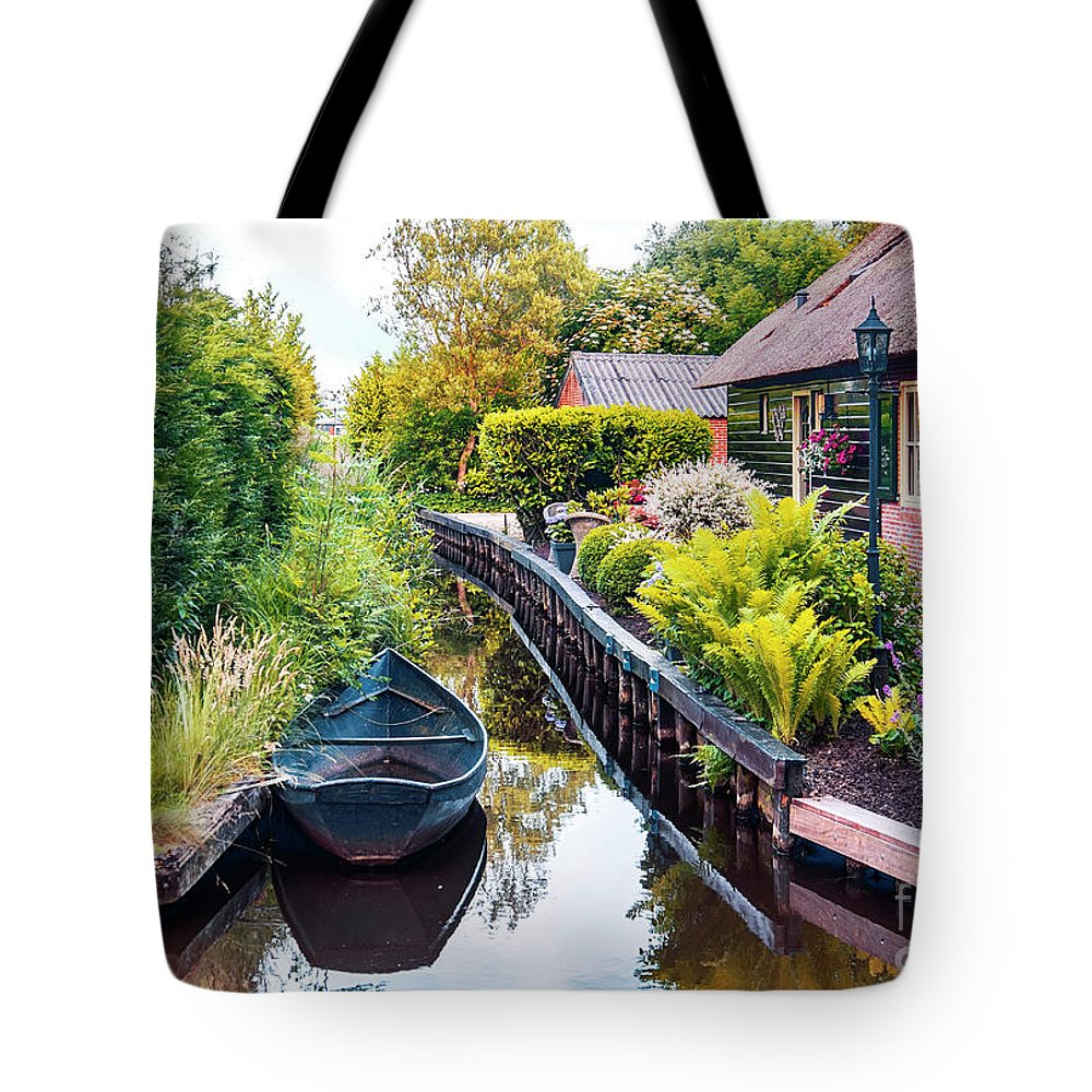 Water Tote Bag featuring the photograph Bridge And River In Old Dutch Village by Ariadna De Raadt