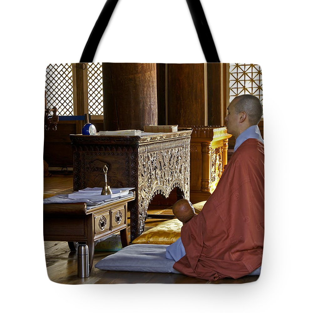 Asia Tote Bag featuring the photograph Buddhist Monk In Prayer by Michele Burgess