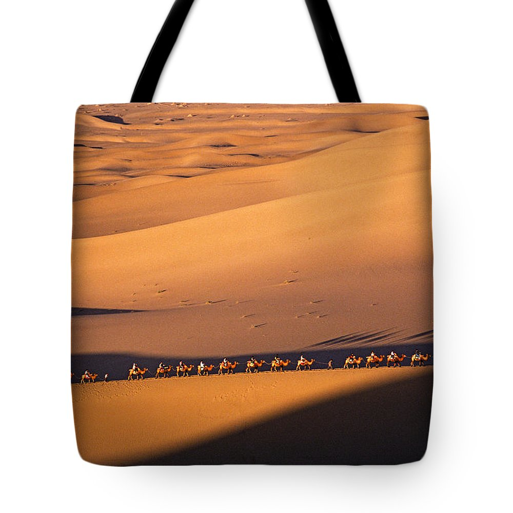 Asia Tote Bag featuring the photograph Camel Caravan Crosses The Dunes by Michele Burgess