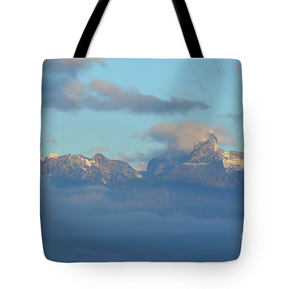 Mountains Tote Bag featuring the photograph Cloudy Sky Surrounding The Dolomite Mountains In Italy by DejaVu Designs
