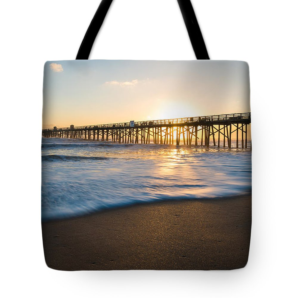 Flagler Beach Tote Bag featuring the photograph Colorful Start by Kristopher Schoenleber