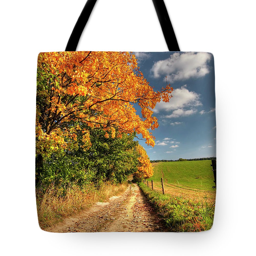 Autumn Tote Bag featuring the photograph Country Road And Autumn Landscape by Michal Boubin