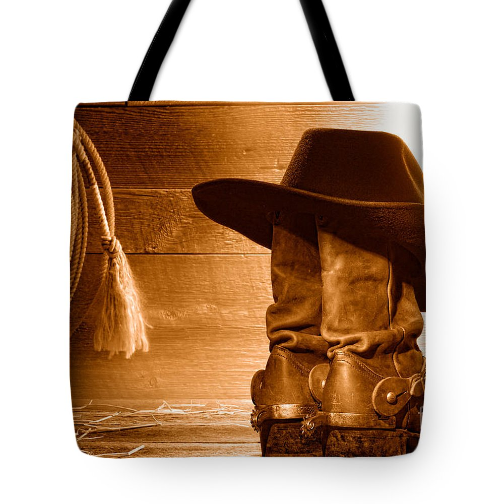 Western Tote Bag featuring the photograph Cowboy Hat On Boots - Sepia by Olivier Le Queinec