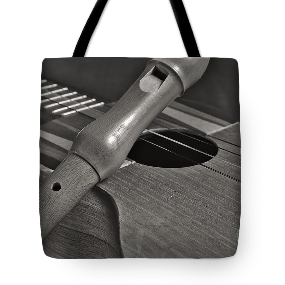 Cuatro Tote Bag featuring the photograph Cuatro Guitar And Flute by Angelo DeVal