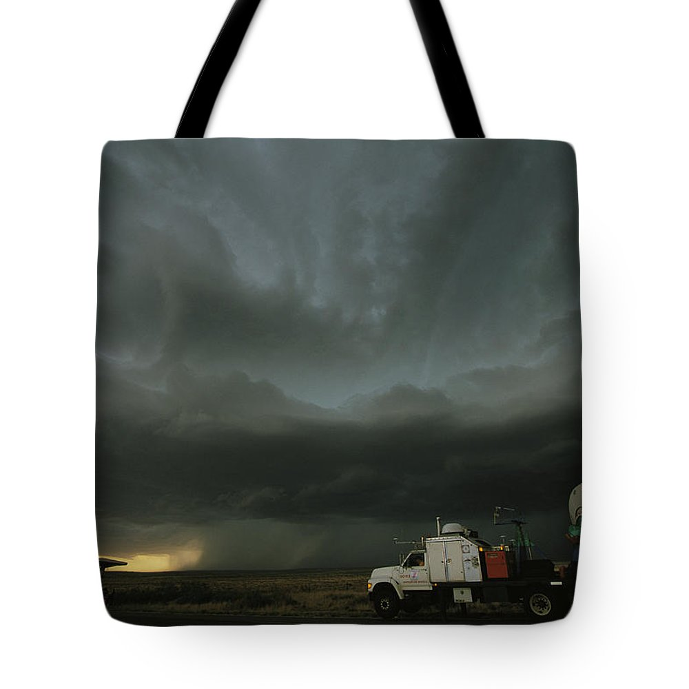 Outdoors Tote Bag featuring the photograph Doppler On Wheels Radar Trucks Wait by Carsten Peter