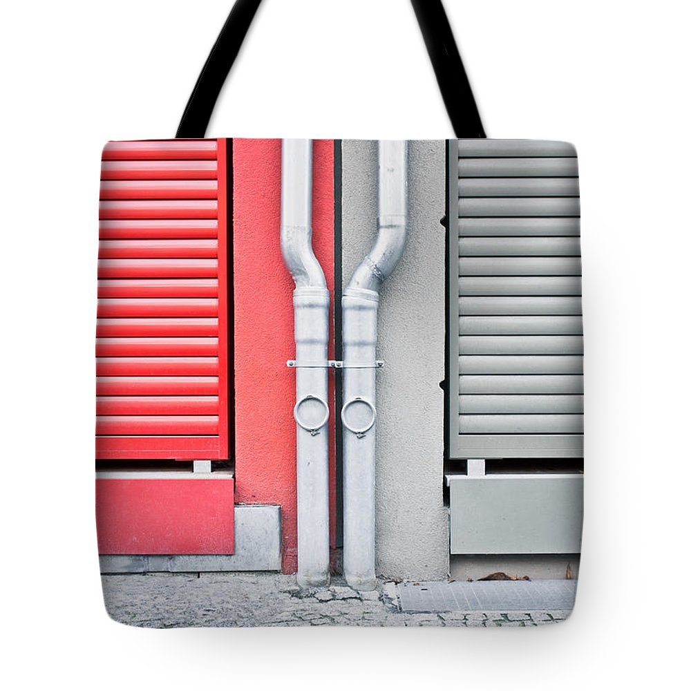 Abstract Tote Bag featuring the photograph Drain Pipes by Tom Gowanlock