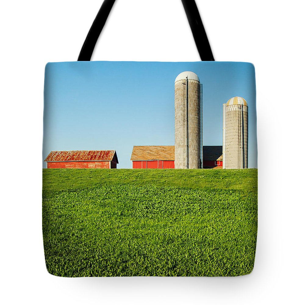 Silos Tote Bag featuring the photograph On Green And Blue by Todd Klassy