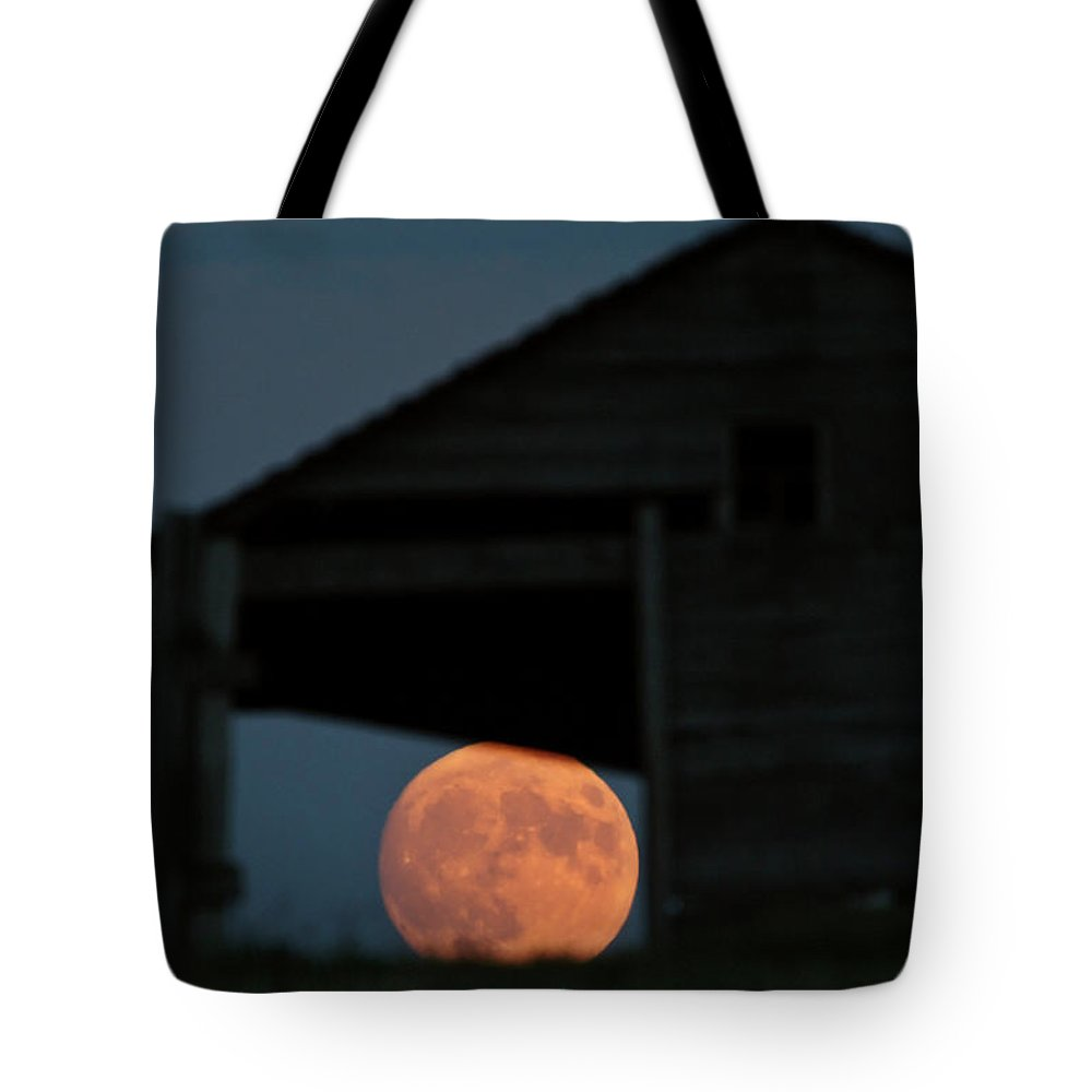 Full Moon Tote Bag featuring the digital art Full Moon Seen Through Old Building Window by Mark Duffy
