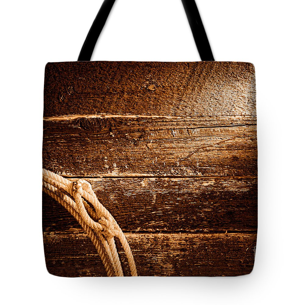 Cowboy Tote Bag featuring the photograph Grunge Lasso - Sepia by Olivier Le Queinec