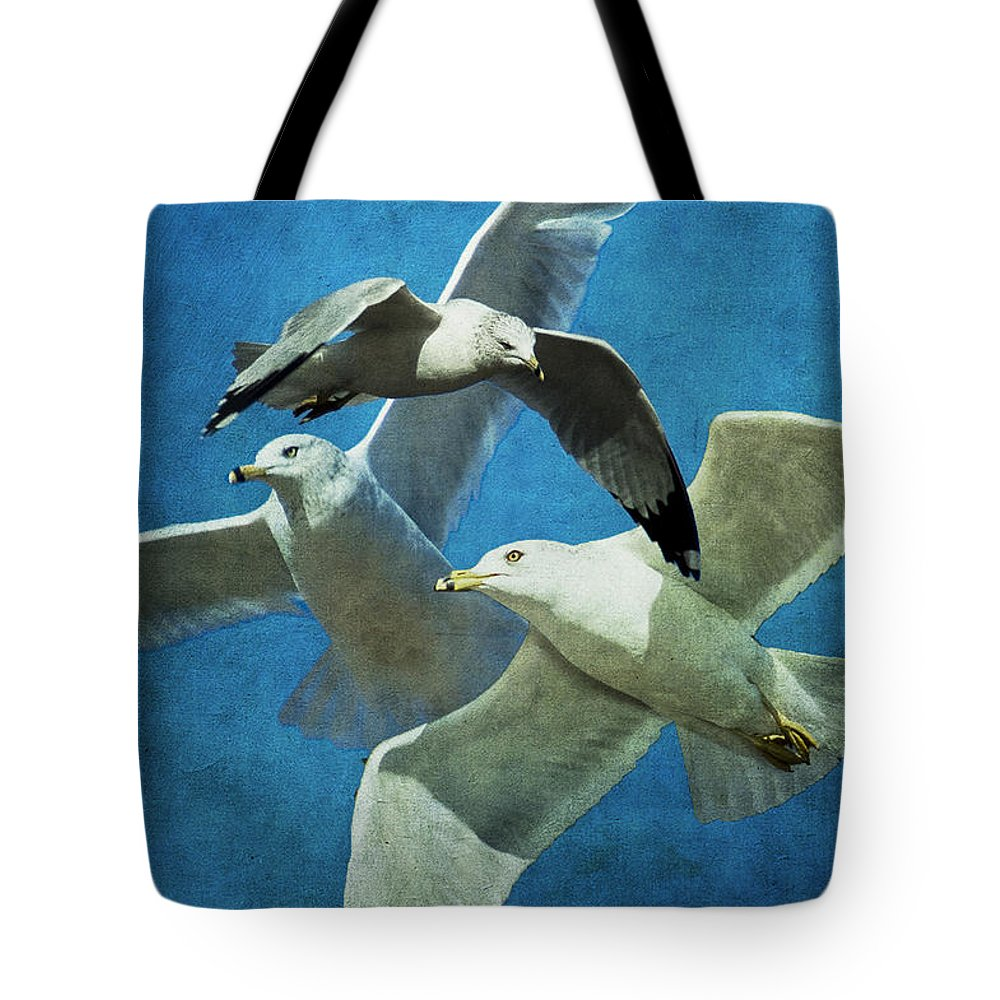 Gulls Tote Bag featuring the photograph Gulls In Flight by Annette Persinger